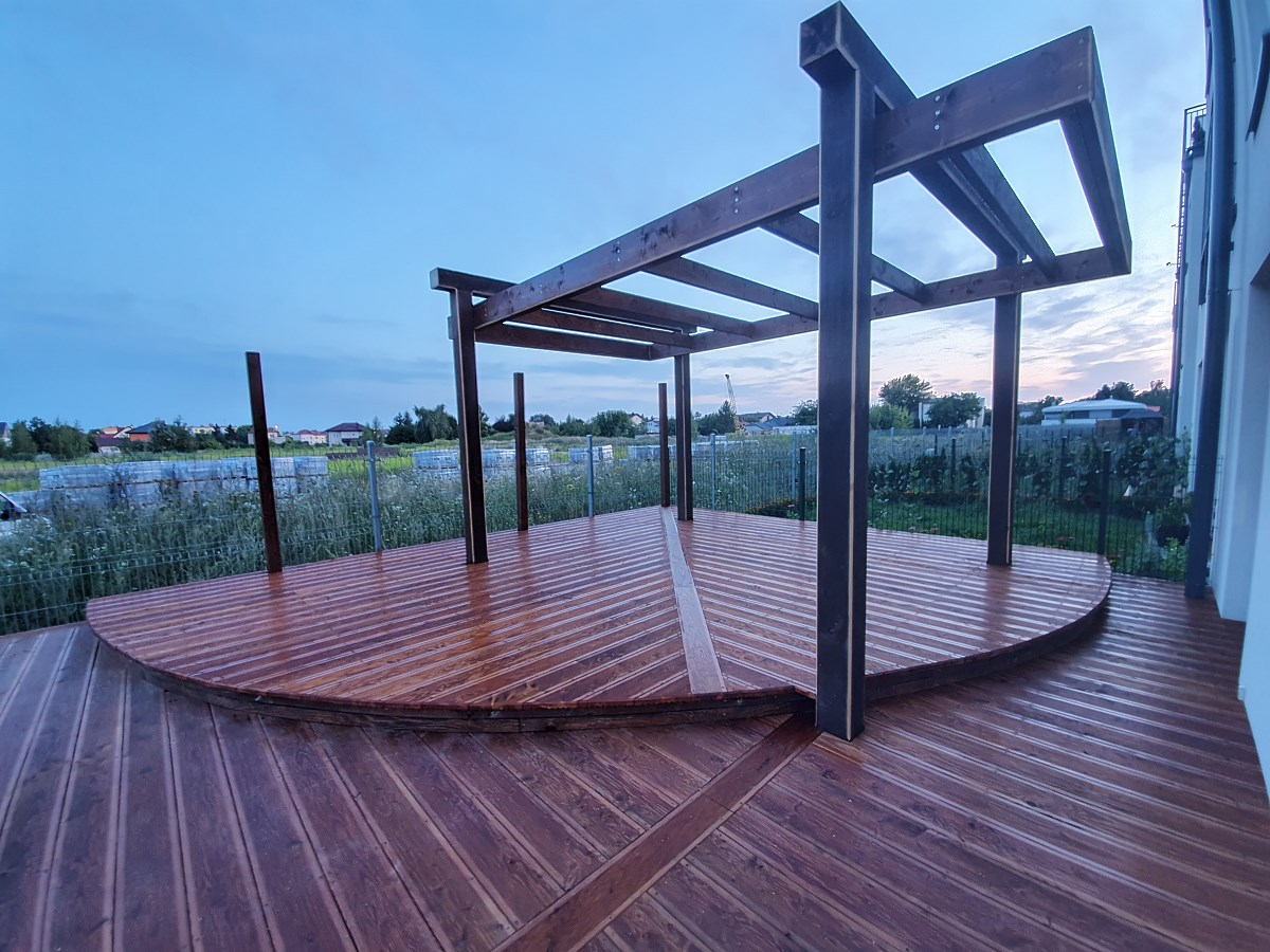 Duchnice/ wooden terrace made of larch wood and pergola""